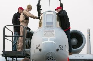 Stammen and Detwiler check out the cockpit of a jet aboard the USS Stennis.