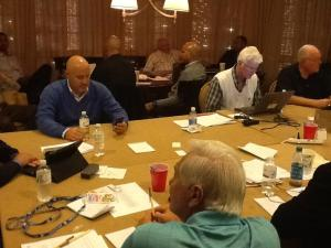 Mike Rizzo and company strategize in the Nationals team suite at the Baseball Winter Meetings.