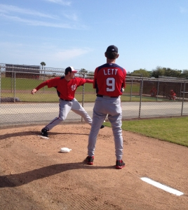 Bullpen Coach Jim Lett looks on as Ohlendorf throws in the 'pen.