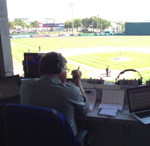 Carpenter calls Friday's game from the press box at Space Coast Stadium.