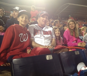 The whole Gear family - Logan, dad J.R., sister Jordan and mom Jennifer, take in a Nats Spring Training game.