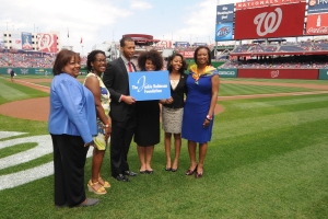 Kendra Gaither (right) with several Jackie Robinson Foundation Scholars at Nationals Park on Sunday.