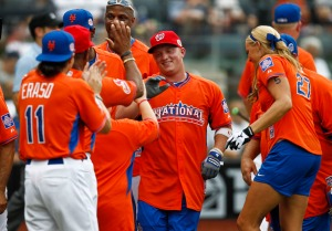 Wege celebrates his home run with his teammates (Jeff Zelevansky)