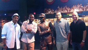 From left to right, Tarasco, Span, Desmond and Hairston pose with a statue of Buck Leonard.