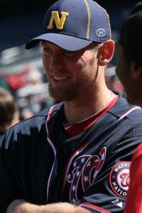 Stephen Straburg and other Nationals players and coaches wore Navy hats in support of those affected by Monday's tragedy.