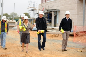 New Nationals Manager Matt Williams (center) tours the Academy site with Principal Owner and chairperson of the Washington Nationals Dream Foundation Marla Lerner Tanenbaum (left) and Executive Director of the Youth Baseball Academy Tal Alter (right).