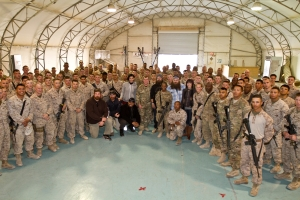 The group posed with Marines before leaving Camp Leatherneck.