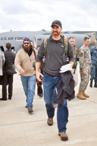 "Nationals first baseman Adam LaRoche and Jep Robertson of A&E's ""Duck Dynasty"" exits a U.S. Air Force C-17 aircraft upon landing at Souda Bay, Greece on December 7 as part of the 2013 Chairman USO Holiday Tour. (Mike Clifton/USO)"
