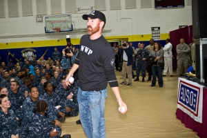 Nationals first baseman Adam LaRoche tosses souvenir baseballs to servicemen and women during a USO tour stop in Greece as part of the 2013 Chairman USO Holiday tour. (Mike Clifton/USO)