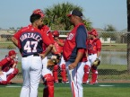 Gio Gonzalez, Wilson Ramos and Livan Hernandez chat after a bullpen session.