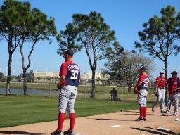 Stephen Strasburg and Jordan Zimmermann work in the bullpen.