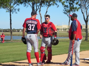 Stephen Strasburg and Jose Lobaton chat with Livan Hernandez after Strasburg's bullpen.