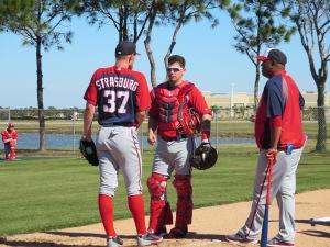 Stephen Strasburg and Jose Lobaton chat with Livan Hernandez after Strasburg's bullpen.