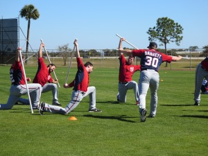 Pitchers stretch after the workout.