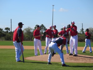 Livan Hernandez and Matt Williams work with the pitchers on fielding bunts.