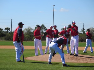 Livan Hernandez and Matt Williams work with the pitchers on fielding bunts.