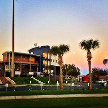 The moon sets behind Space Coast Stadium on Sunday morning.