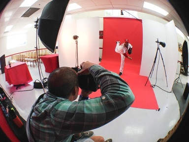 Ryan Mattheus works for photographer Donald Miralle during his photo shoot.