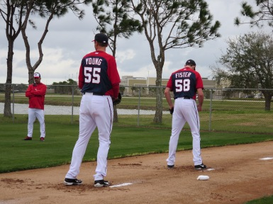 Chris Young and new Nationals right-hander Doug Fister throw in the bullpen on Saturday.