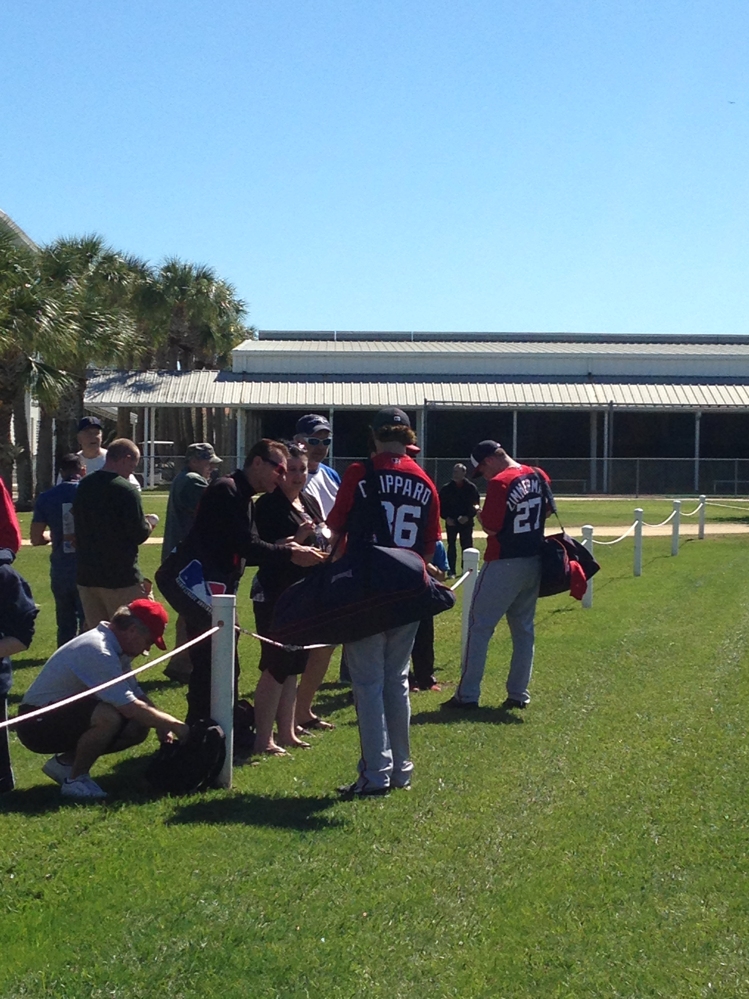 Tyler Clippard and Jordan Zimmermann sign autographs.