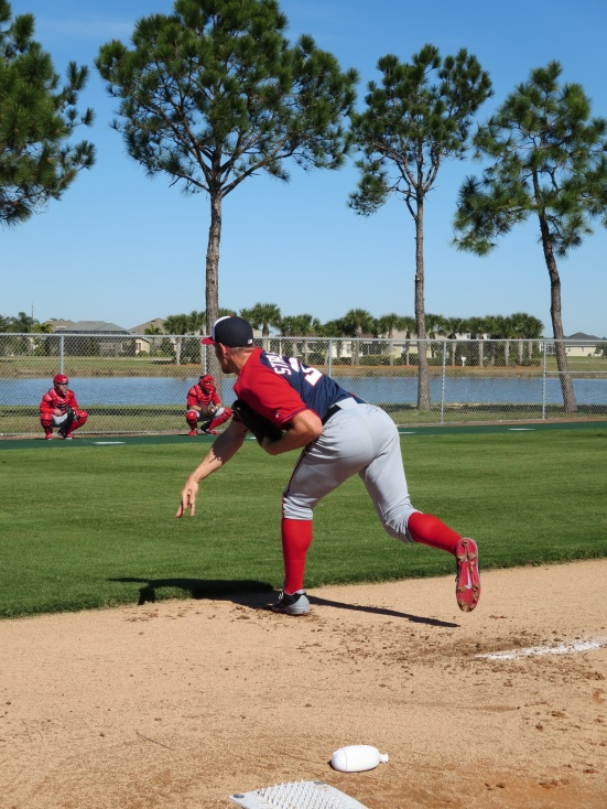 Stephen Strasburg throws a pitch in his first bullpen of the spring.