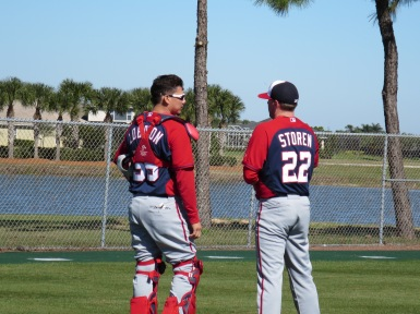 Jose Lobaton chats with Drew Storen after he caught Storen's bullpen session.