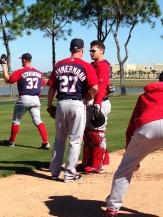 Jordan Zimmermann and Jose Lobaton chat after Zimmermann's bullpen session.