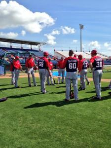 Some Nationals pitchers prepare for a new hitting game during Monday's workout.
