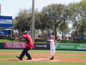 Sergeant Morris and his grandson Javone throw out their first pitches.