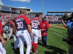 Sergeant Morris is greeted by Nationals players.