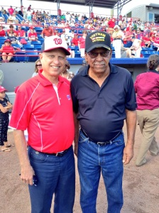 Sergeant Melvin Morris and Mark Lerner, one of the Nationals principal owners, before Sergeant Morris' first pitch.
