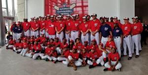 Washington Nationals players pose with students from the Washington Nationals Youth Baseball Academy.