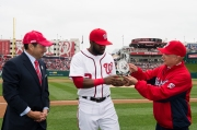 Denard Span accepted his Wilson Defensive Player of the Year Award from two of the Nationals' Principal Owners, Mark D. Lerner, right, and Robert K. Tanenbaum, left.