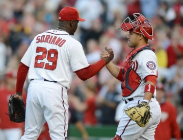 Rafael Soriano and Sandy Leon celebrate the final out of the sweep over the Marlins.