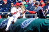 Ian Desmond signs autographs for fans before the game.