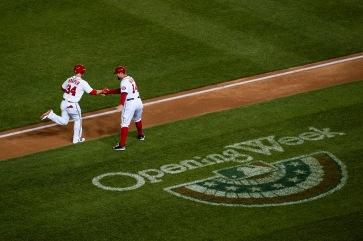 Third base coach Bob Henley congratulates Bryce Harper after his majestic three-run home run into the third deck in right field.