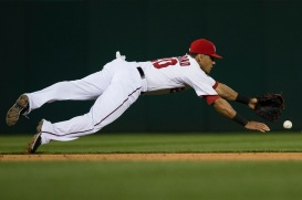 Ian Desmond lays out to make a play.