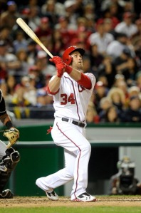 Bryce Harper watches the flight of his monstrous three-run home run.