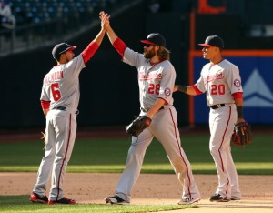 Anthony Rendon, Jayson Werth and Ian Desmond celebrate the win.