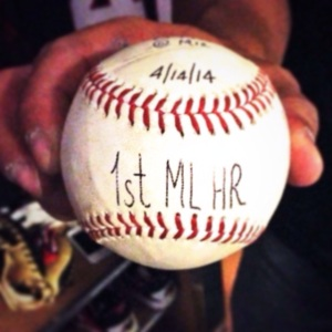 Sandy Leon holds the ball he hit for his first MLB home run.
