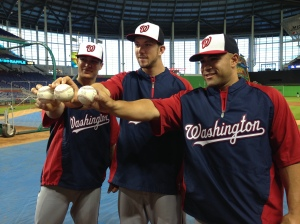 "Zach Walters, left, Steven Souza Jr., center, and Sandy Leon, right, hold the baseballs used in their various MLB ""firsts"" before a game in Miami this week."