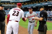 Nationals Manager Matt Williams and Diamondbacks Manager Kirk Gibson, who used to have Williams as his third base coach, shake hands before the first pitch. (Photo courtesy of Jennifer Stewart/Arizona Diamondbacks)