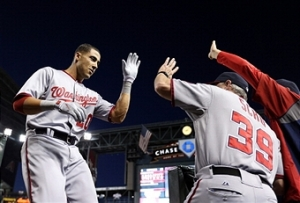 Ian Desmond is greeted at the dugout steps following his two-run home run.