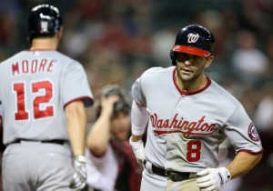 Danny Espinosa crosses home plate after his game-tying home run in the ninth.