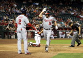 Kevin Frandsen greets Denard Span after Frandsen's go-ahead home run in the ninth.