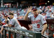 Nationals Manager Matt Williams waves to the crowd after a classy tribute video is shown on the scoreboard for the former Diamondbacks player and coach.