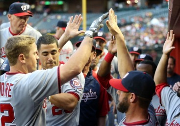 Tyler Moore gets a warm welcome in the dugout after his solo home run.