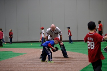 Manager Matt Williams works on infield form with this lucky fan.