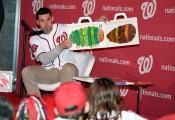 Ryan Zimmerman reads to Jr. Nats fans.